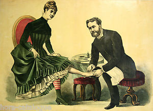 man performing european pedicure on woman